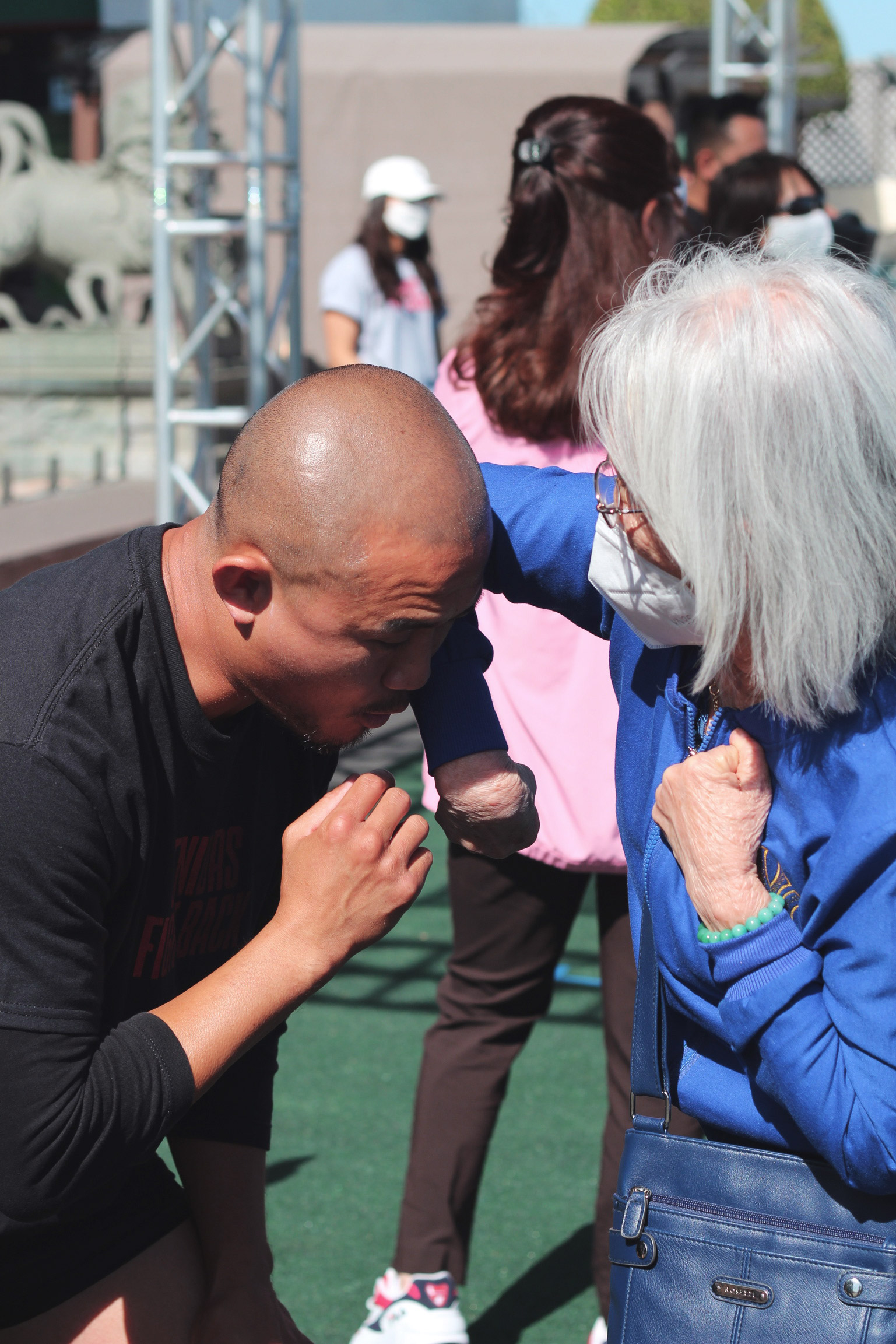 elderly woman learning how to elbow strike